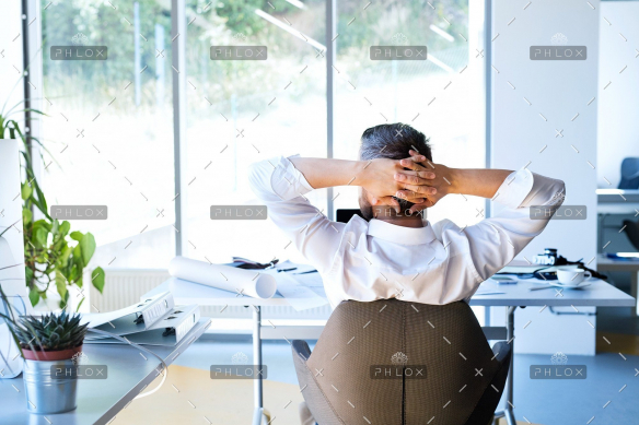 demo-attachment-31-Businessman-at-the-desk-in-his-office-resting.
