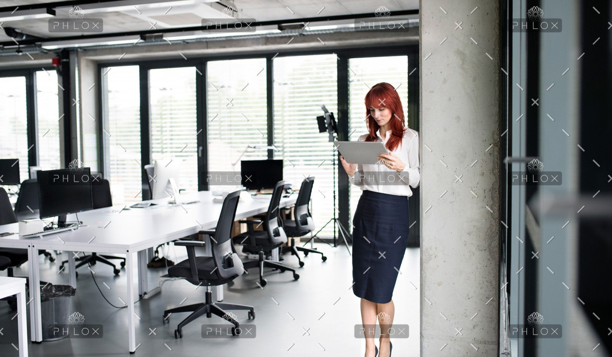 demo-attachment-32-Businesswoman-with-tablet-in-her-office-working.