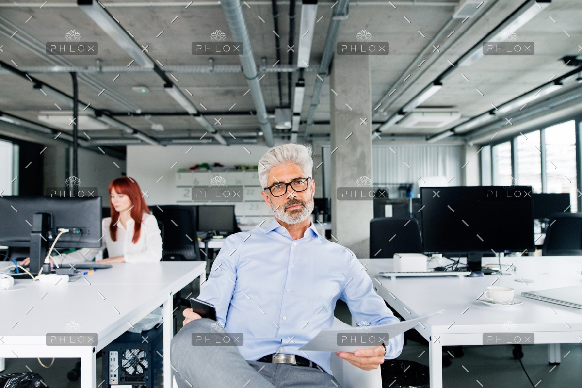 demo-attachment-35-two-business-people-in-the-office-working-PSUQY8T
